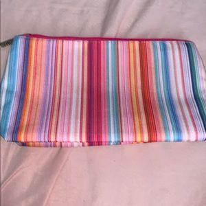Multicolored Clinique makeup bag